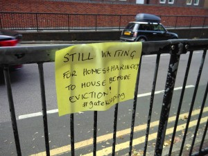 Still waiting for Homes4Haringey - sign on railing