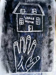 Handmade black and white print depicting a house with 'Share Home' written on it and a hand with 'Home' written on it.